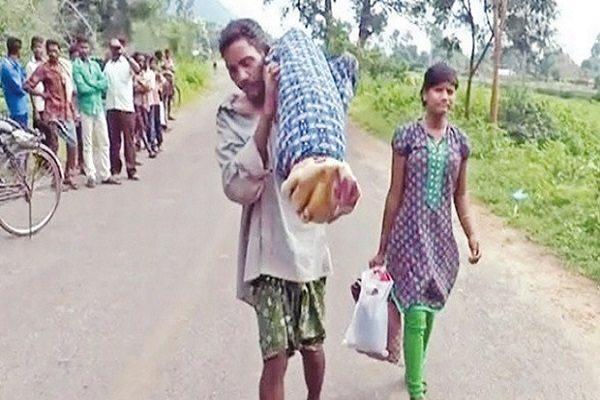 man carrying wifes dead body in shoulder m odisha Kalahandi