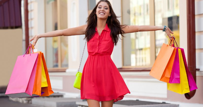 happy woman walking with shopping bags; Shutterstock ID 109344689; PO: aol; Job: production; Client: drone