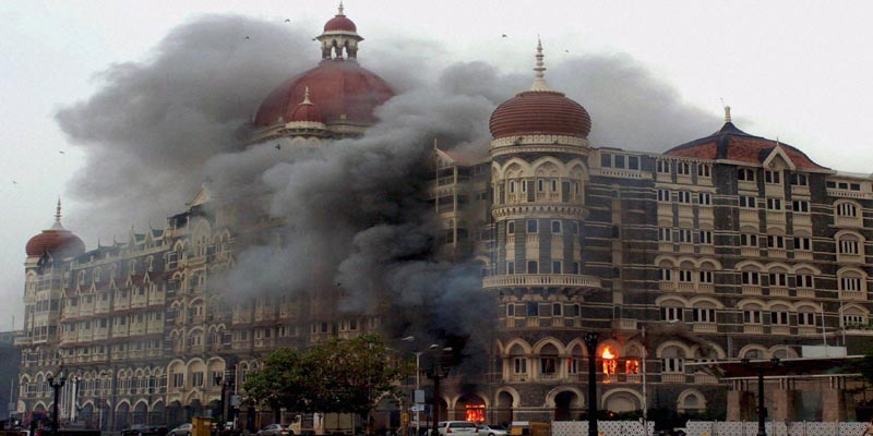 "Mumbai: **FILE** Smoke is seen billowing out of the ground and first floor of the Taj Hotel in south Mumbai during security personnel's ""Operation Cyclone"" following the 26/11 terror attacks in 2008. Pakistani gunman Ajmal Amir Kasab, the sole surviving Pakistani gunman involved in the Mumbai attacks, was hanged to death at the Yerawada central prison in Pune on Wednesday morning. PTI Photo (PTI11_21_2012_000014B)"