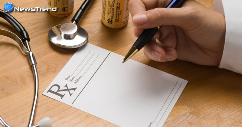 doctor write rx on drug prescription