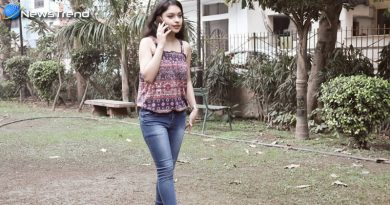 Girl Sleeveless Top and Jeans