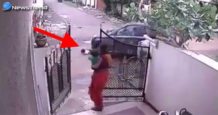 बच्ची के ऊपर से गुज़रा कार, लेकिन एक खरोंच नहीं आयी बच्ची को... वीडियो वायरल!