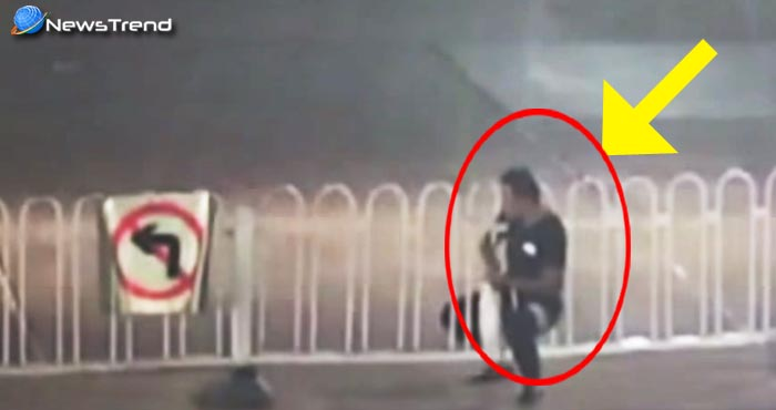 वीडियो : चालाकी दिखाने के चक्कर में बीच सड़क के डिवाइडर में फंस गया यह व्यक्ति!