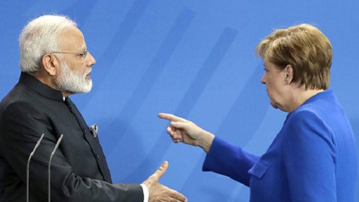 Merkel again ignores modi handshake