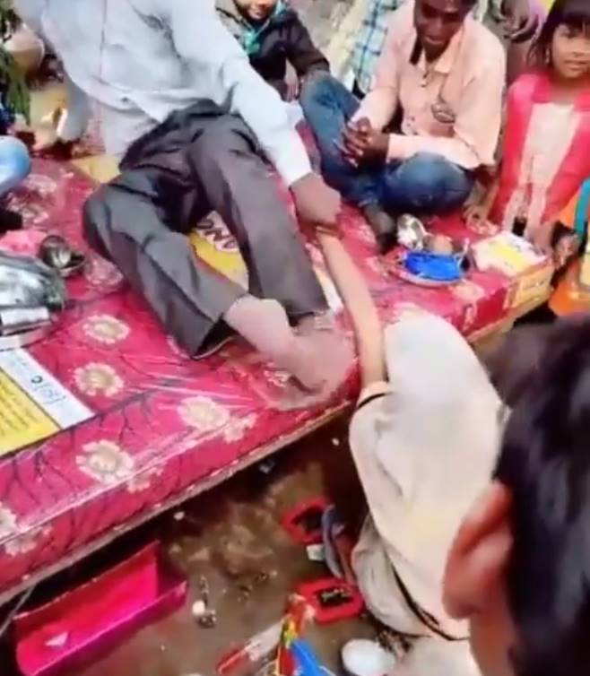 groom woman on ground