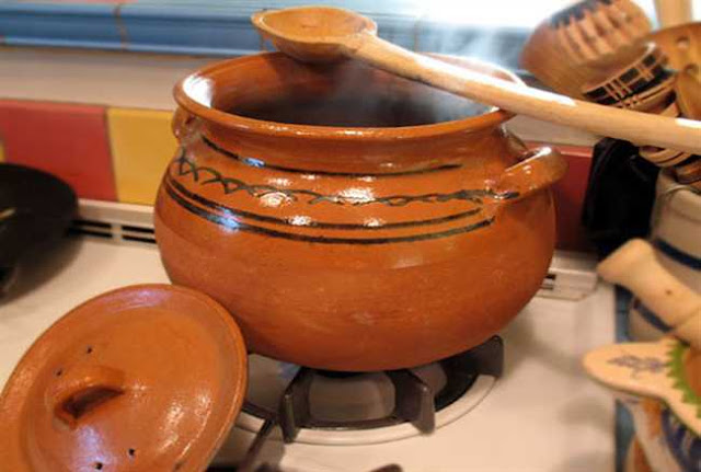 food in clay pot