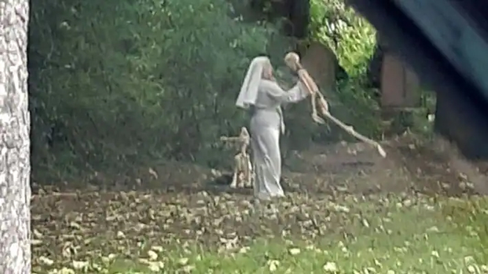 england-woman-spotted-dancing-with-human-and-dog-skeletons